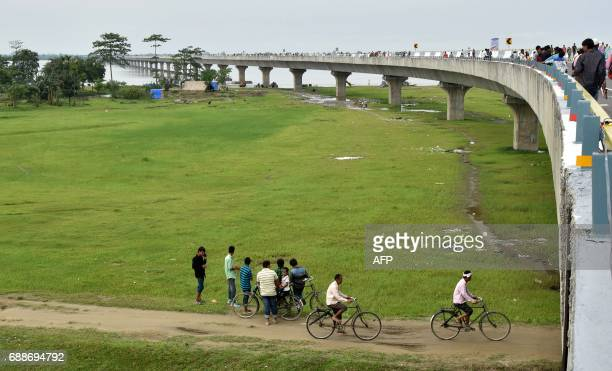 TOPSHOT People gather by the DholaSadiya bridge across the River Lohit a tributary of the River Brahmaputra which was inaugurated by Indian Prime...