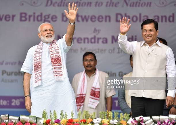 Indian Prime Minister Narendra Modi and Sarbananda Sonwal chief minister of Assam state wave to the crowd as they inaugurate the DholaSadiya bridge...