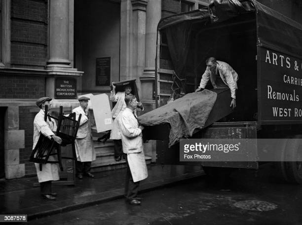 Carrying office furniture from the BBC at Savoy Hill as the corportion moves its headquarters to Broadcasting House Portland Place