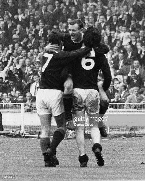Bobby Lennox is congratulated by team mates Willie Wallace and Jim Baxter after scoring Scotland's second goal against England at Wembley Scotland...
