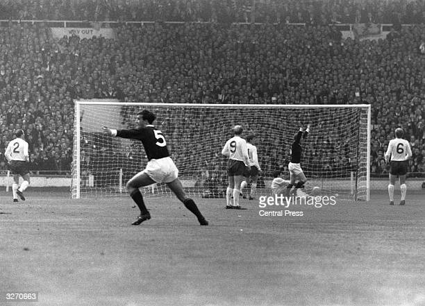 Scotland's insideleft Denis Law raises both arms after scoring during an international match between England and Scotland at Wembley Stadium From...