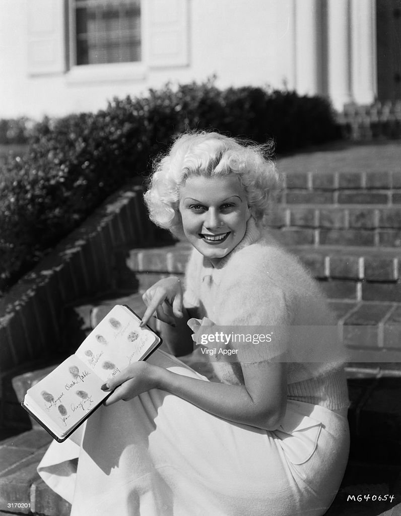 MGM star <a gi-track='captionPersonalityLinkClicked' href=/galleries/search?phrase=Jean+Harlow&family=editorial&specificpeople=70012 ng-click='$event.stopPropagation()'>Jean Harlow</a> (Harlean Carpentier) (1911 - 1937) with her book of autographed fingerprints including those of Joan Crawford and Clark Gable.