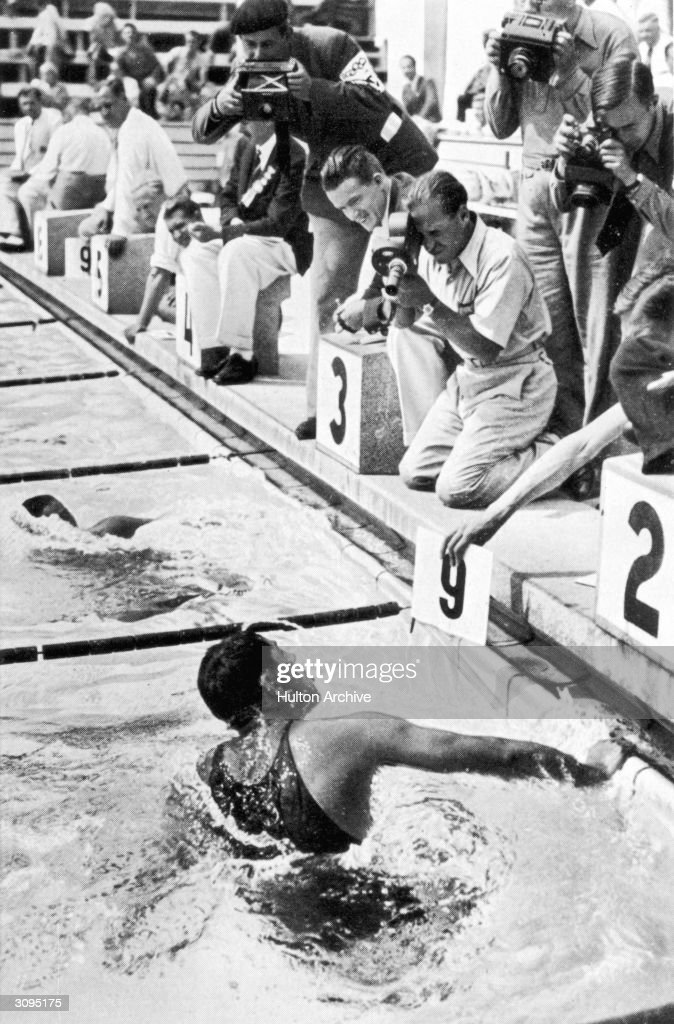 American swimmer Jack Medica turning at the start of his ninth length in the 1500 metres freestyle event at the 1936 Berlin Olympics. He finished second after Noboru Terada of Japan.