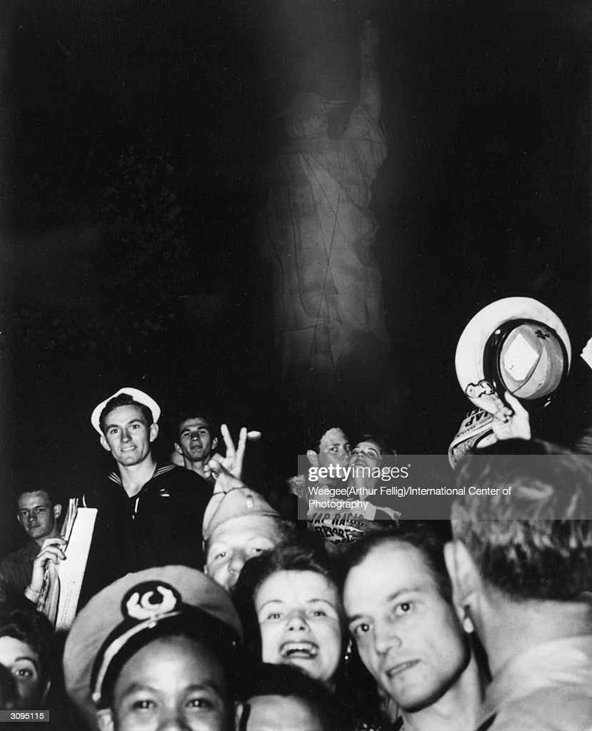 Crowds celebrating V-J Day at the Times Square Statue of Liberty. (Photo by Weegee(Arthur Fellig)/International Center of Photography/Getty Images)