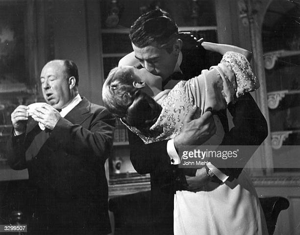 This candid shot of director Alfred Hitchcock with American actor Gregory Peck and actress Ann Todd received second prize in the 4th Hollywood...