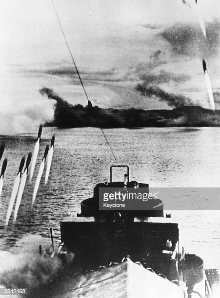A dawn attack on the island of Mindoro in the Philippines An American LCI releases a barrage of missiles aimed at Japanese beach defences as the...