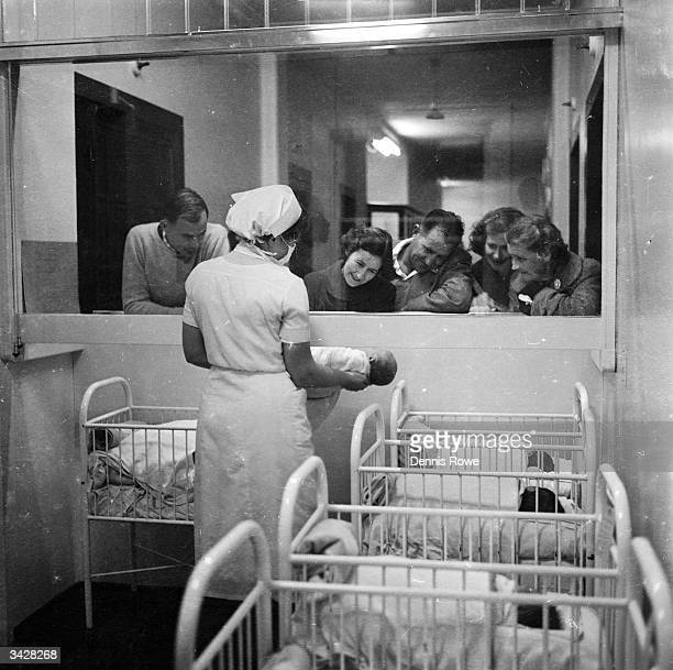 An observation window enables visiting fathers to look at their newborn offspring at the Maternity Ward of the North Shore Hospital in Sydney