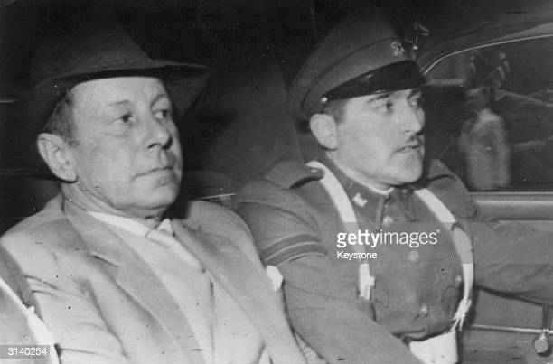 Former Nazi SS Obersturmbannfhrer Walter Rauff in a car with a Chilean policeman after his arrest in Punta Arenas Rauff supervised the outfitting and...