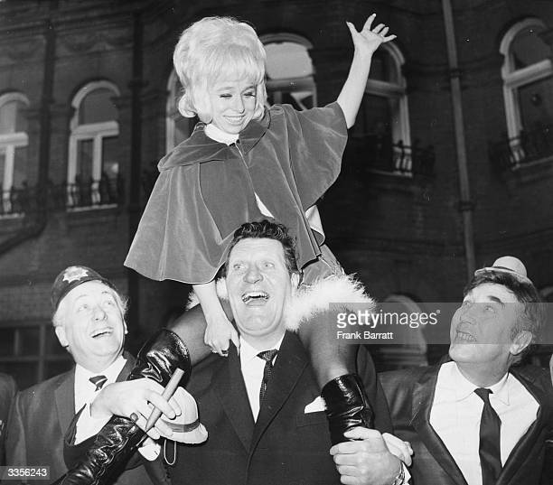 British film and television stars Hughie Green Barbara Windsor Tommy Cooper and Frankie Howerd promoting ITV's Christmas programmes