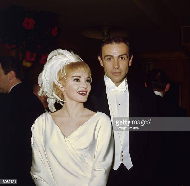 American actress Diane Cilento with her husband Sean Connery at the Royal Film Performance of 'Lord Jim'