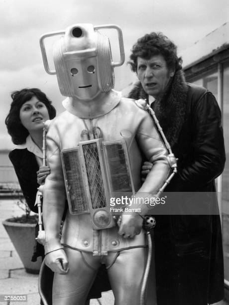 Tom Baker as the new Dr Who for the popular BBC tv children's series He is shown here with a Cyberman and his assistant Sarah Jane Smith played by...