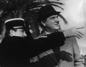 A gendarme gives directions to US actor Karl Malden in Nice France