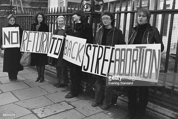 A group of women demonstrating in favour of legal abortions with a banner declaring 'No Return To Backstreet Abortions'