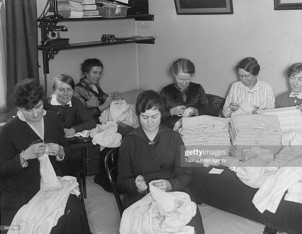 A group of women sewing underwear for the Union Jack Club.