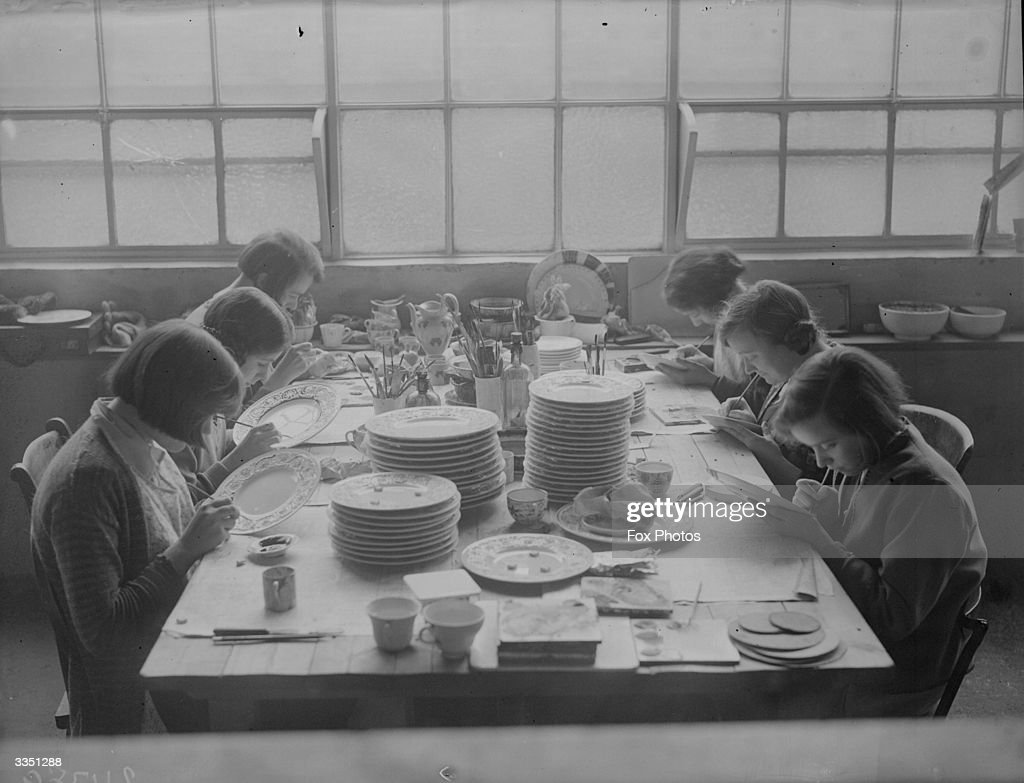 Women painting decoration on to plates at the Wedgwood pottery Stoke On Trent Staffordshire
