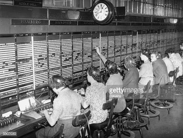 Telephone operators receive long distance calls from Germany at the international exchange in the Faraday Building Queen Victoria Street London
