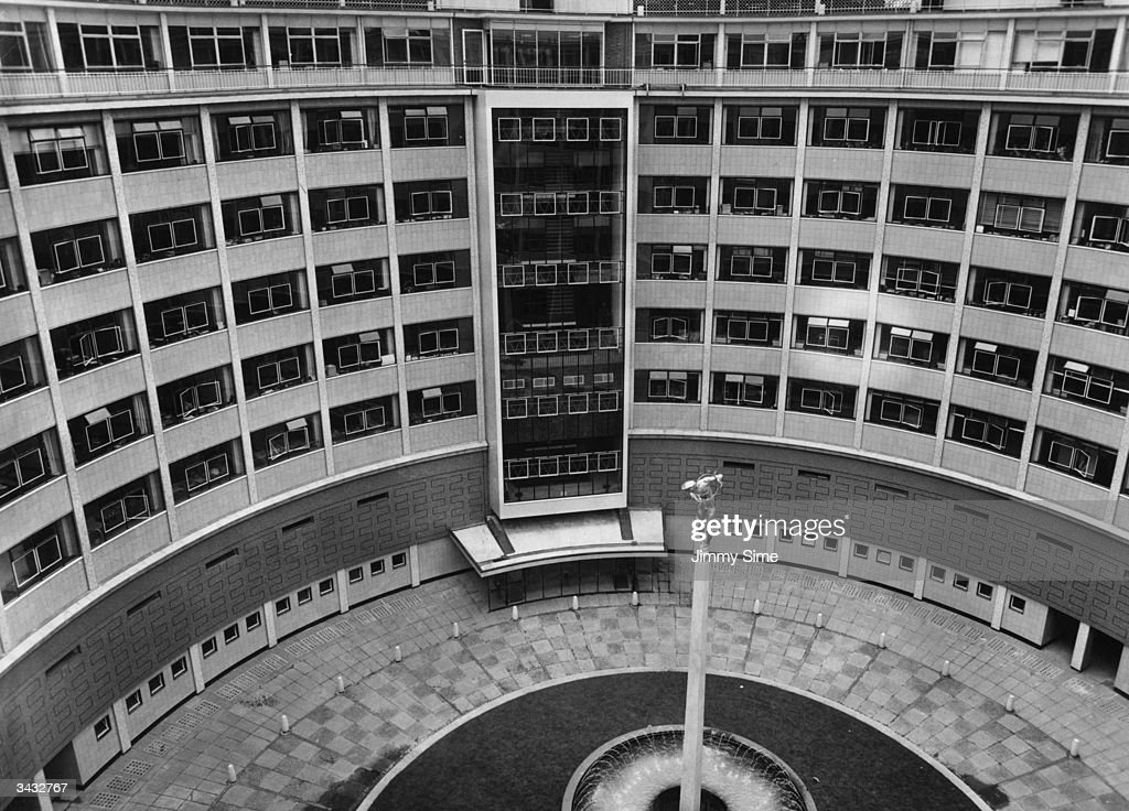 The circular main block of BBC Television Centre at White City London In the centre of the courtyard is a fountain with an elevated statue of Helios...