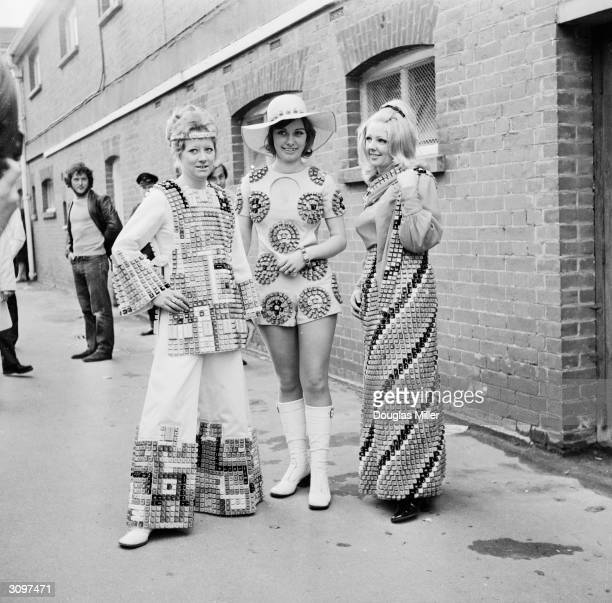Three young employees of a computer firm Diana Slater Susan Halliwell and Jenny Fancy at Royal Ascot races wearing costumes to demonstrate the new...