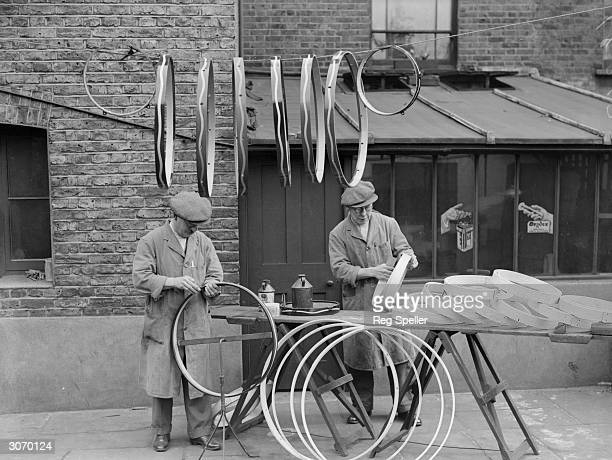 Workers at Messrs Cummings Kennington London making drums most of which go to the British and Indian Armies