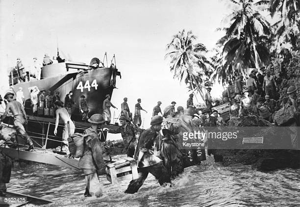New Zealand troops landing on Green Island's palm fringed beach 135 miles west of New Britain