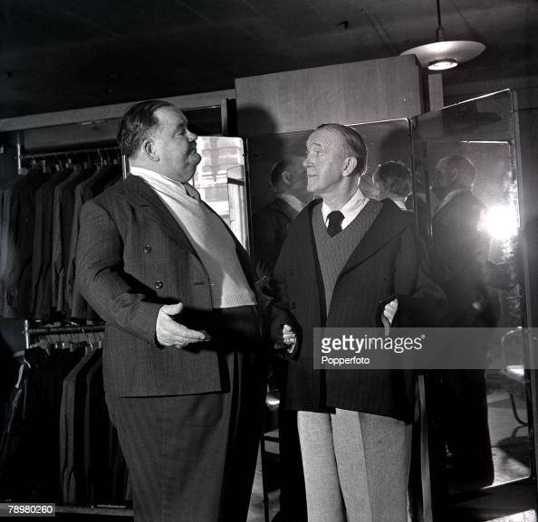 15th March 1947 American comedy duo Stan Laurel and Oliver Hardy the film comedians are pictured at menswear store in London's West End