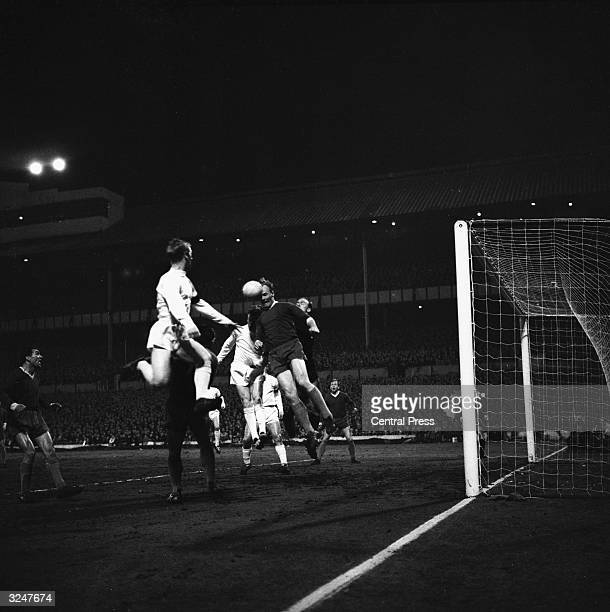 Schroif the Slovan Bratislava keeper jumps above the players after a Tottenham Hotspur corner during the quarter final of the European CupWinners'...