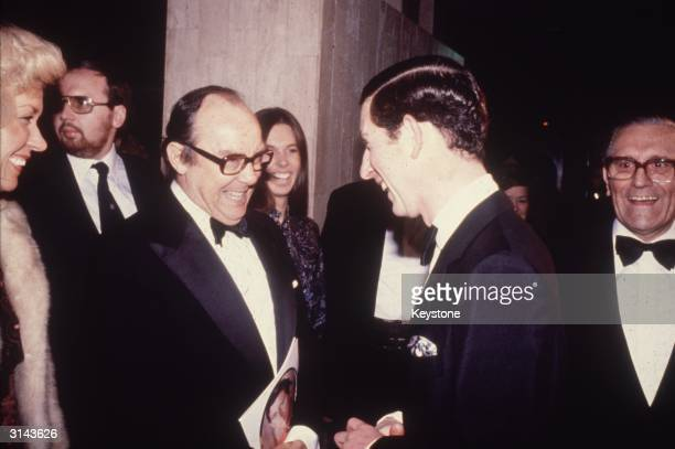 Prince Charles meeting the English comedian Eric Morecambe at a charity concert at the Wembley Conference Centre