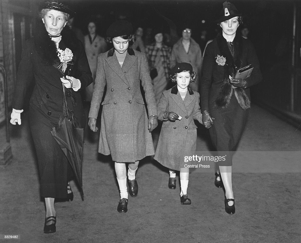 Princess Elizabeth and Princess Margaret (1930 - 2002) with Lady Helen Graham and Miss Marion Crawford ('Crawfie'- Princess Elizabeth's governess) after their first ride on the Underground..