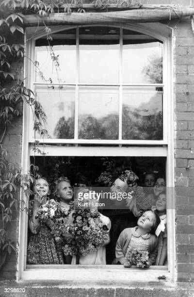 Hollywood film star Carmen Miranda waiting for the rain to stop during May Day festivities at Weston Turville in Buckinghamshire Original Publication...