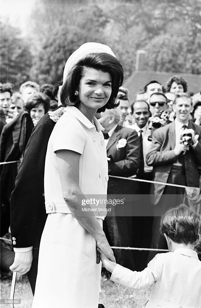 <a gi-track='captionPersonalityLinkClicked' href=/galleries/search?phrase=Jacqueline+Kennedy&family=editorial&specificpeople=70028 ng-click='$event.stopPropagation()'>Jacqueline Kennedy</a> (1929 - 1994) attends the inauguration of a memorial to her husband John F. Kennedy in Runnymede, Surrey, nearly eighteen months after his assassination. Holding her hand is her young son, John F. Kennedy Jr. (1960 - 1999).