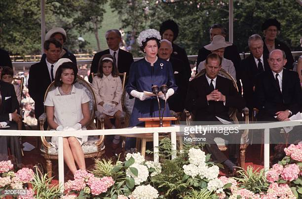 Queen Elizabeth II and Prince Philip with Jackie Kennedy and her daughter Caroline during the inauguration of Britain's Kennedy memorial at Runnymede