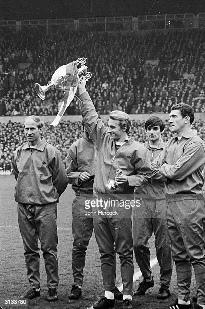 Manchester United footballers Bobby Charlton Denis Law George Best and Billy Foulkes celebrating after winning the League Championship