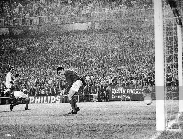 Manchester United keeper Alex Stepney lets the ball go through his legs for Francisco Gento to score Real Madrid's second goal in the European Cup...