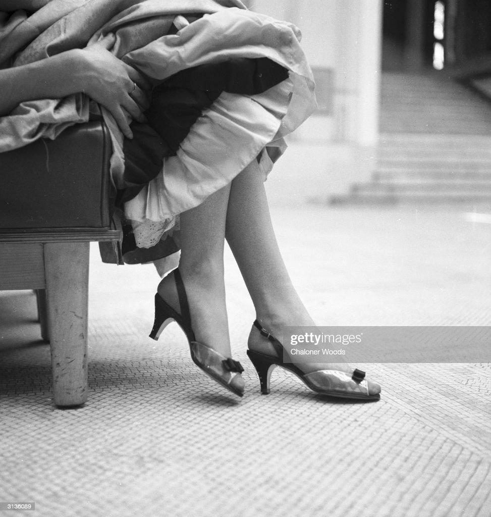 Sling back peeptoed evening shoes with slim high heels