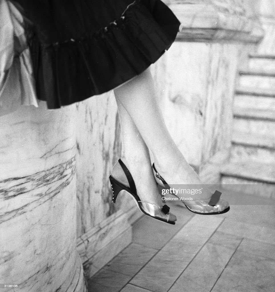 Sling back peeptoed evening shoes with slim high heels which are decorated down the back