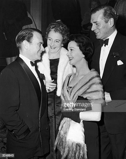 Left to right film actor John Mills his wife Mary Hayley Bell film actress Vivien Leigh and her husband Laurence Olivier at the Savoy Theatre London