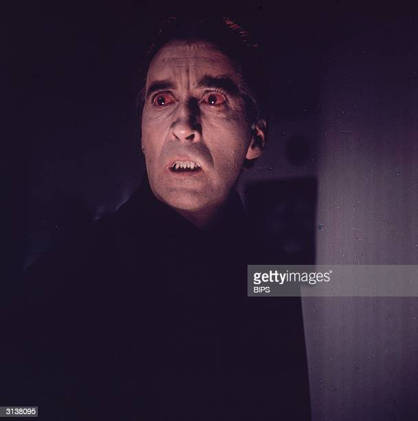 English actor Christopher Lee playing a vampire in one of the many horror films he has starred in