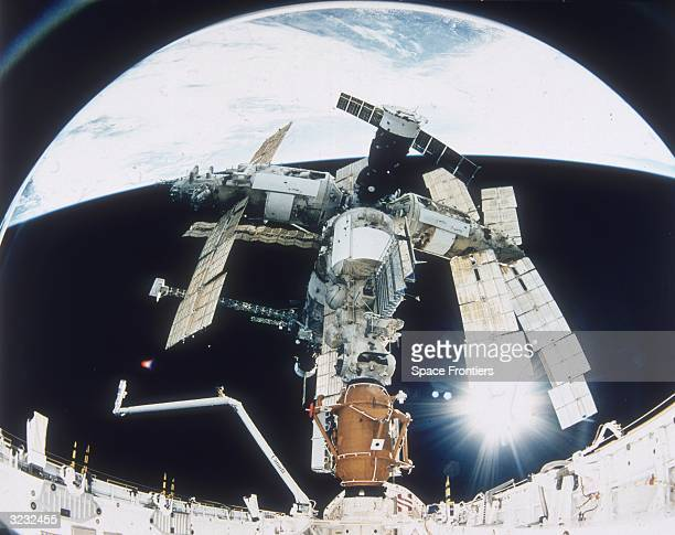 NASA's STS74 Atlantis Space Shuttle docked with Russia's MIR Space Station This mission is part of the first phase of the International Space Program...