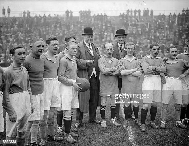 English sportsman Hugh Cecil Lowther 5th Earl of Lonsdale with some of the jockeys playing in the North v South Country charity football match at...