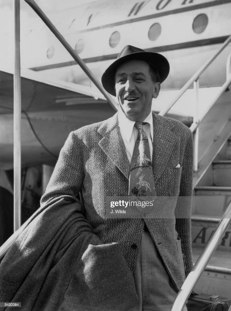 American cartoonist and film producer Walt Disney (1901 - 1966) arrives at London Airport.