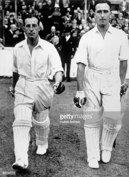 Denis Compton walks out onto the Oval ground London with batting partner Bill Edrich