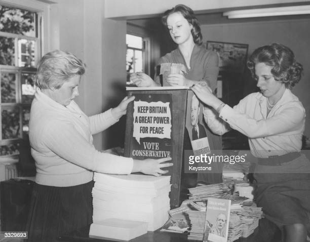 A group of women organise election propaganda at the Conservative Party central office in London