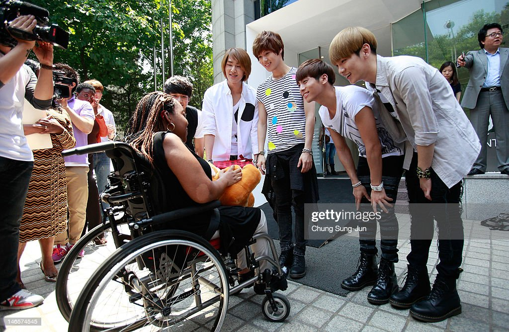 15-year old American girl Donica Streling meets with members of SHINee and Super Junior at SM Entertainment head office on June 20, 2012 in Seoul, South Korea. Donica, diagnosed with Charcot-Marie-Tooth disease, visited Seoul, South Korea to meet her favorite K-pop groups SHINee and Super Junior after finding hope in listening to Korean pop.