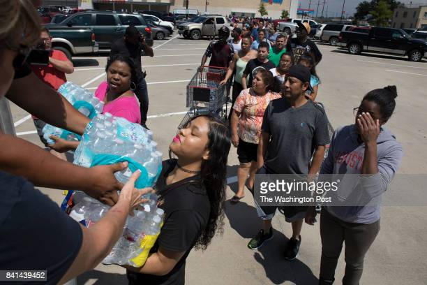 15yearold Kyra Simien gets water for her family from Faith Hope and Love Ministries who drove a van load of water from Fort Worth Texas and parked in...