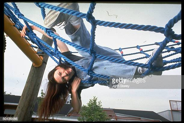 15yrold actress Claire Danes romping on rope jungle gym