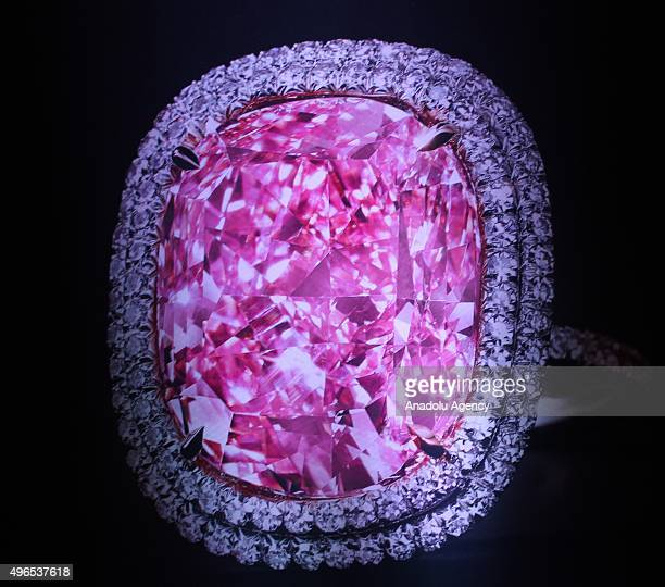 1608carat vivid pink diamond set in a ring and rounded with a double row of smaller white diamonds has sold at auction for 287 million Swiss francs...