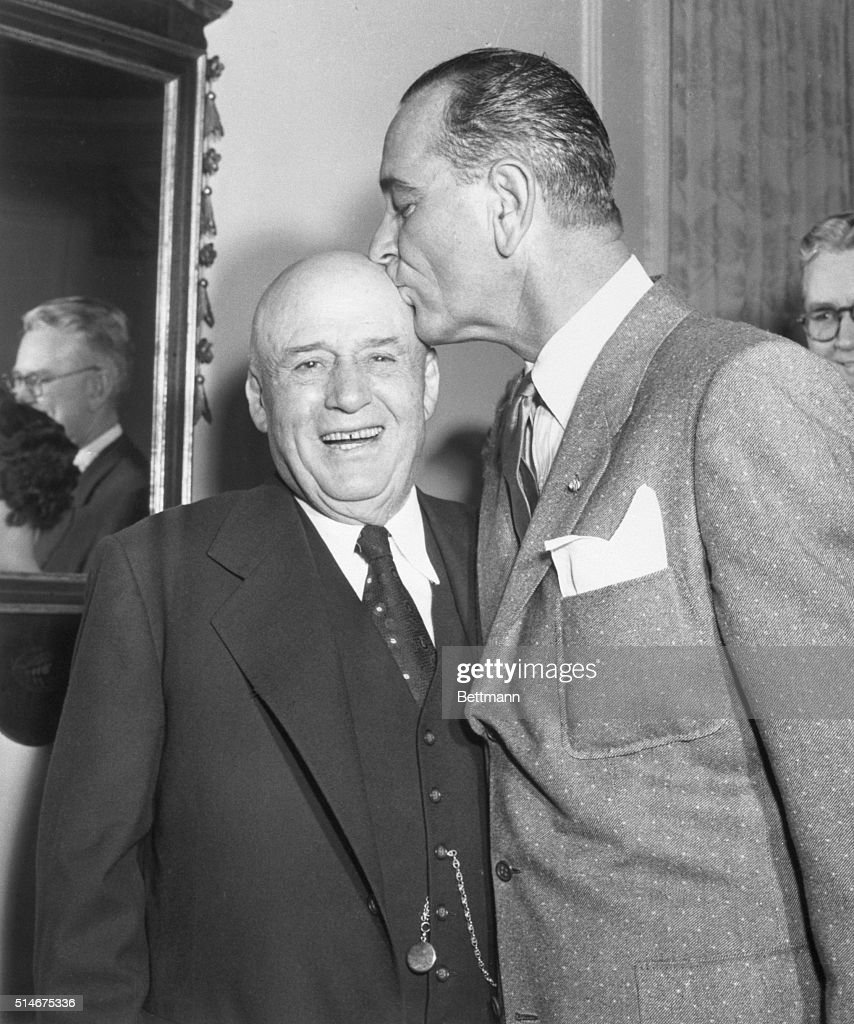 Speaker of the House of Representatives Sam Rayburn (Left) gets a kiss on the head from Senate Majority leader Lyndon B. Johnson during a party in honor of Rayburn's 76th birthday here today. The party was given by the Woman's Democratic Club.