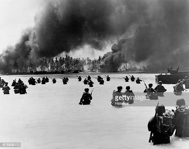 165th Infantry assault wave attacking Butaritari Yellow Beach Two find it slow going in the coral bottom waters Japanese machine gun fire from the...