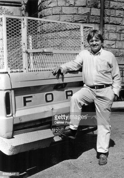OCT 12 1987 10/4/87 16th And Washington Wally Barrett Goodwill man who operates a Charity Called 'Wally's Winos Inc standing next to his old pickup...