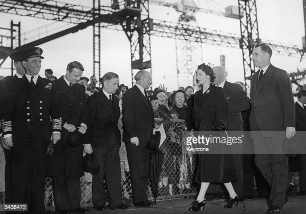 Queen Elizabeth II on her way to perform the launching ceremony of the new Royal Yacht Britannia at the John Brown shipyard Clydebank On her right is...